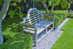 A Lutyens bench is one of the focal points in this country garden design.