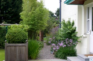 Container planting softens the formal garden design.
